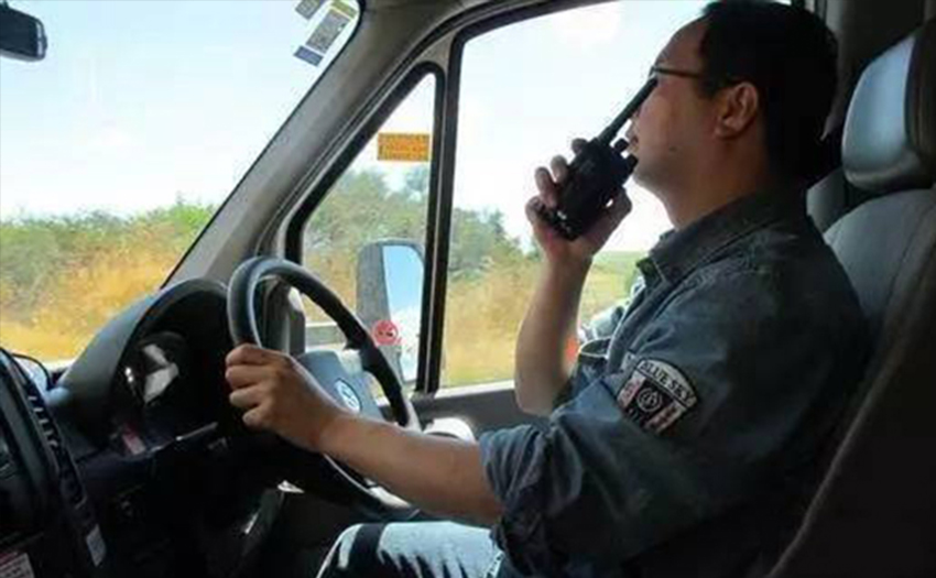 Why do drivers who run long-distance buses carry walkie-talkies?